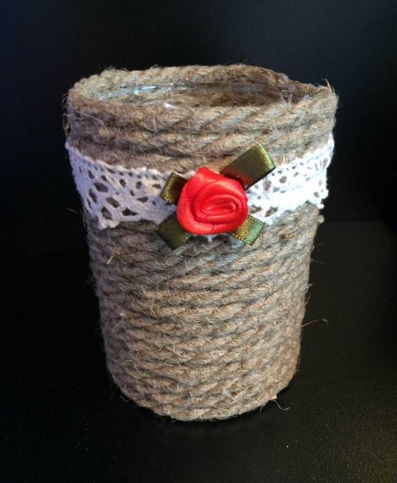 Küünla alus punane roos 12.80 valgel paelal